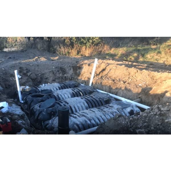 Underground rainwater collection tank buried